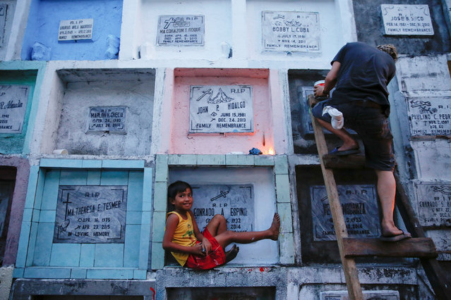People visit apartment-style tombs of their loved ones ahead of the commemoration of All Saints day at Navotas Public cemetery in Manila, Philippines, October 31, 2016. (Photo by Damir Sagolj/Reuters)