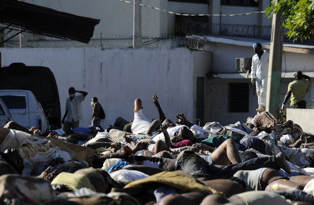 Bodies pile up at the city morgue as trucks collect the dead from the earthquake in Port-au-Prince, Haiti on January 15, 2010. (Photo by Carol Guzy/The Washington Post via Getty Images)