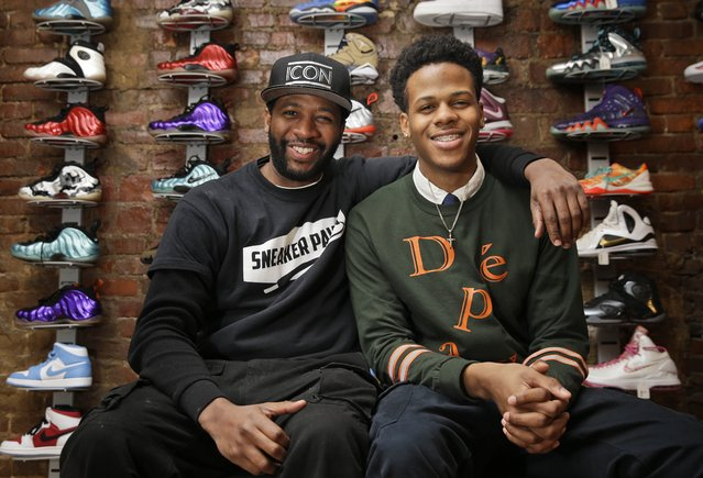 Entrepreneurs Chase Reed, right, and his father Troy Reed pose for a picture in their store in the Harlem section of New York. The Reeds run Sneaker Pawn, a store that capitalizes on America's multi-billion dollar athletic footwear market and the high prices sneakers can get being re-sold. (Photo by Seth Wenig/AP Photo)