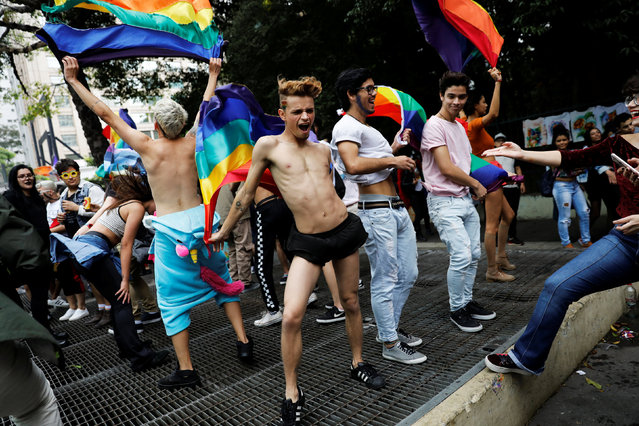 Revellers dance as they take part in the Gay Pride parade along Paulista Avenue in Sao Paulo, Brazil on June 3, 2018. (Photo by Nacho Doce/Reuters)