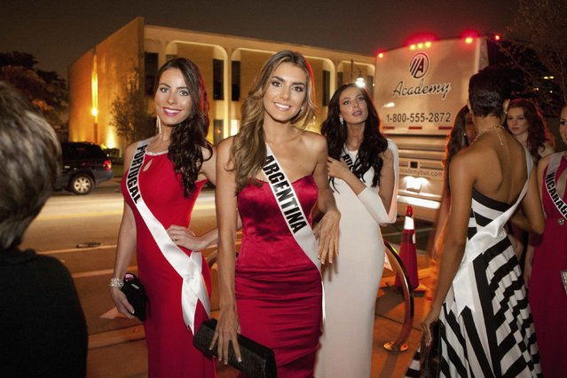 Miss Portugal 2014 Patricia Da Silva, Miss Argentina 2014 Valentina Ferrer and Miss Russia 2014 Yulia Alipova pose during the Miss Universe Welcome Event at Downtown Doral Park in Miami in this January 9, 2015 handout photo provided by the Miss Universe Organization. (Photo by Richard D. Salyer/Reuters/Miss Universe Organization)