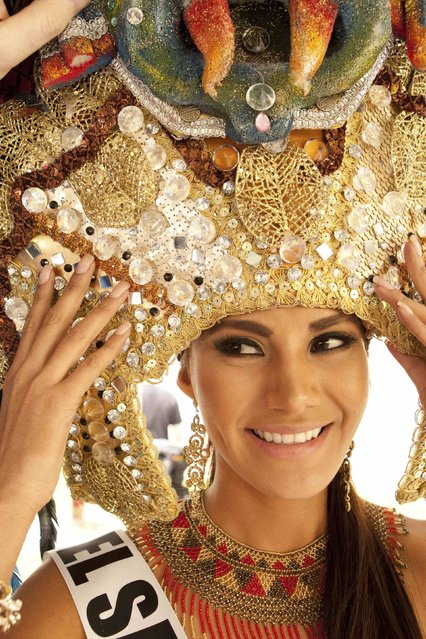 Patricia Murillo, Miss El Salvador 2014, tries on her costume during rehearsals during the 63rd annual Miss Universe Pageant in Miami, Florida in this January 20, 2015 handout photo. (Photo by Reuters/Miss Universe Organization)