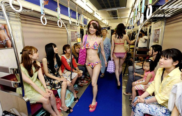 On 7 July, 2013 a parade of swimsuit was held in the Osaka subway. (Photo by NEWSCOM/SIPA)