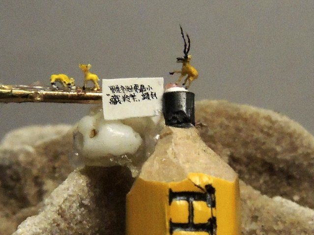 Miniature resin figurines of Tibetan antelopes are displayed on a pencil tip and a needle, in Taipei January 28, 2015. (Photo by Pichi Chuang/Reuters)
