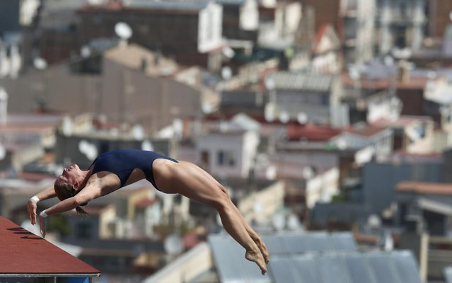 Noemi Batki from Italy performs during the women's 10-meter platform preliminary at the FINA Swimming World Championships in Barcelona, Spain, Wednesday, July 24, 2013. (Photo by Michael Sohn/AP Photo)