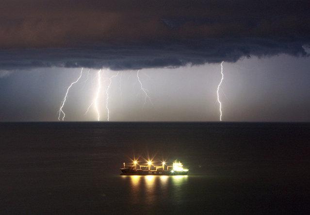 Lightning illuminates the sky offshore Beirut, October 2008. (Photo by Jamal Saidi/Reuters)
