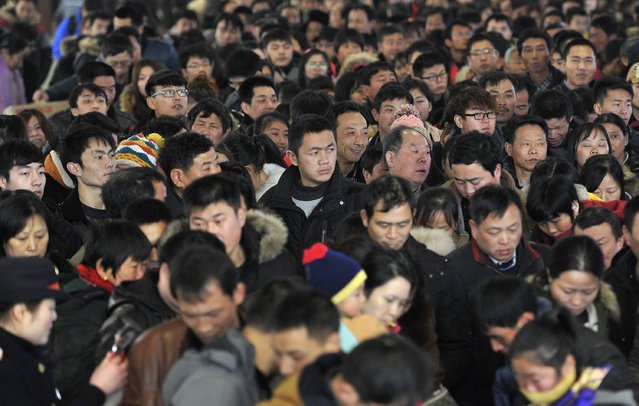 Passengers wait to board a train at a railway station in Hefei, Anhui province February 3, 2015. (Photo by Reuters/Stringer)