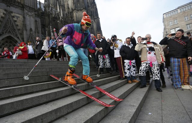 "A man skis down the steps during ""Weiberfastnacht"" (Women's Carnival) in Cologne February 12, 2015. (Photo by Ina Fassbender/Reuters)"