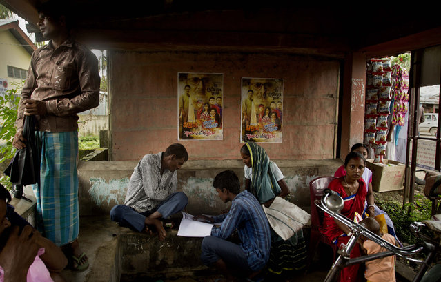 People whose names were left out in the National Register of Citizens (NRC) draft fill up forms to file appeals near a NRC center on the outskirts of Gauhati, Assam state, India, Monday, August 13, 2018. A draft list of citizens in Assam, released in July, put nearly 4 million people on edge to prove their Indian nationality. (Photo by Anupam Nath/AP Photo)