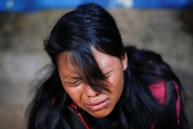 Leydi Tomas, sister of Marvin Alberto Tomas, one of the migrants killed in the Mexican state of Tamaulipas while trying to reach the U.S., cries during the funeral service in Comitancillo, Guatemala, March 13, 2021. (Photo by Luis Echeverria/Reuters)