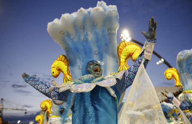 A dancer from the Nene de Vila Matilde samba school performs during a carnival parade in Sao Paulo, Brazil, Saturday, February 14, 2015. (Photo by Andre Penner/AP Photo)