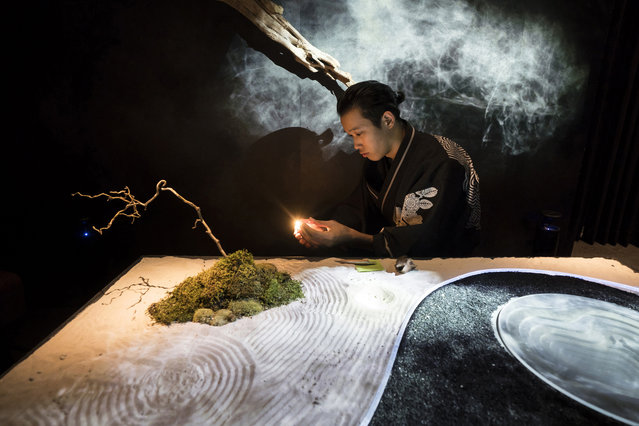 A guide wearing a kimono lights incense in the waiting room of the Tree by Naked, Yoyogi Park restaurant  produced by Naked Inc. on August 16, 2018 in Tokyo, Japan. The latest technologies are utilized in the restaurant offering art gastronomy experiences combining a dinner course, projection mapping, virtual reality, sensing, lighting, smoke, fragrance and music to attract their guests. The restaurant allows only 8 pairs of guests a night and aims to be a new destination for tourists in Japan, with a record 28.7 million people visiting the country in 2017. (Photo by Tomohiro Ohsumi/Getty Images)