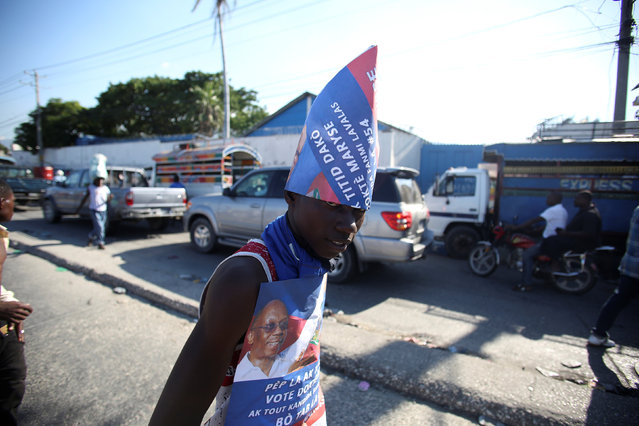 A supporter of presidential candidate Maryse Narcisse, of Fanmi Lavalas party, looks on during a protest in Port-au-Prince, Haiti, November 29, 2016. (Photo by Jeanty Junior Augustin/Reuters)
