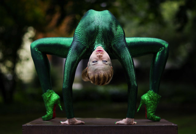 Russian-born contortionist Zlata poses during a photo shooting in a park in Bergisch Gladbach, Germany, 09 September 2013. The international contortionists conference takes place in the city from 09 until 11 September with 100 partcipants from 16 countries. (Photo by Rolf Vennenbernd/EPA)