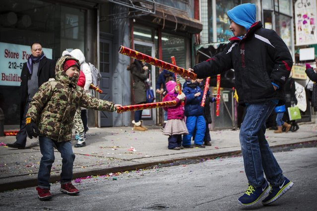 People celebrate Chinese Lunar New Year in New York's China Town February 19, 2015. (Photo by Brendan McDermid/Reuters)