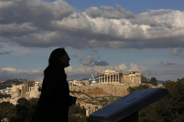 A woman is silhouetted as she visits Filopappou hill, opposite the archaeological site of Acropolis in Athens February 7, 2015. Greece said on Saturday it had no short-term cash problem and that it will hand its European Union partners a comprehensive plan next week for managing the transition to a new debt deal. (Photo by Kostas Tsironis/Reuters)