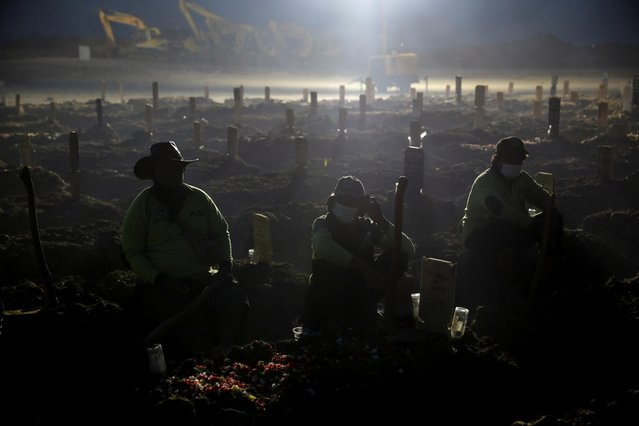 Gravediggers take a break as they work at the burial area provided by the government for coronavirus disease (COVID-19) victims, in Jakarta, Indonesia, June 28, 2021. (Photo by Willy Kurniawan/Reuters)