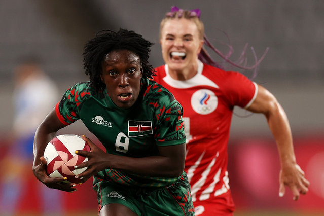 Sinaida Omondi of Team Kenya breaks away from Alena Tiron of Team ROC in the Women's pool A match between Team ROC and Team Kenya during the Rugby Sevens on day six of the Tokyo 2020 Olympic Games at Tokyo Stadium on July 29, 2021 in Chofu, Tokyo, Japan. (Photo by Dan Mullan/Getty Images)