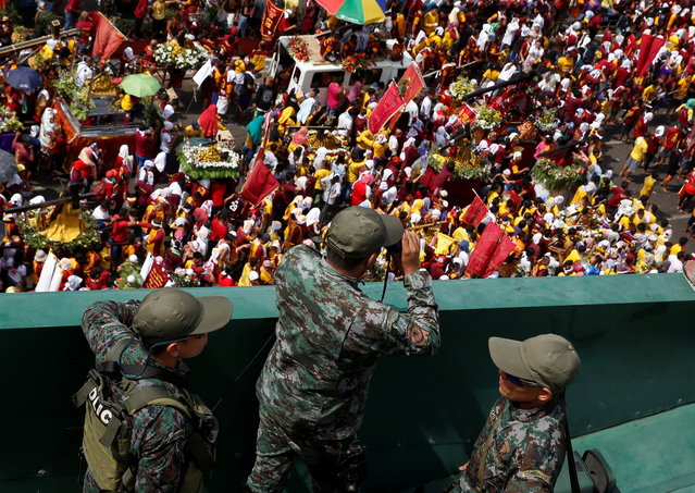 Members of Special Action Force guard the parade of the black statue of Jesus Christ during the annual Black Nazarene Catholic religious procession in Manila, Philippines, January 9, 2017. (Photo by Erik De Castro/Reuters)