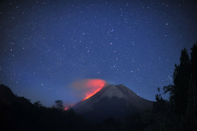 Mount Merapi, Indonesia's most active volcano, spews ash and lava as seen from Sleman in Yogyakarta on August 11, 2021. (Photo by Daffa Ramya Kanzuddin/AFP Photo)