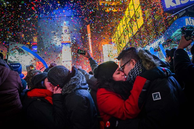 Couples kiss after midnight in Times Square. (Photo by Christopher Gregory/Getty Images)