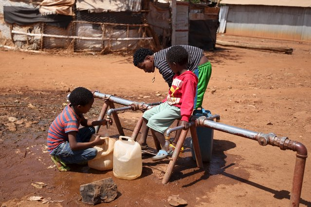Eritrean refugee children fetch water from a tap at Mai-Aini refugee camp near the Eritrean boarder in the Tigrai region in Ethiopia February 10, 2016. (Photo by Tiksa Negeri/Reuters)