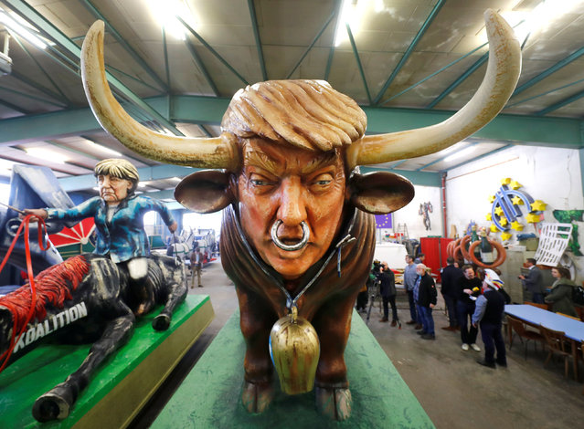A paper mache bull depicting U.S. President Donald Trump is seen during the presentation of the floats for the upcoming Rose Monday parade in Mainz, Germany, February 26, 2019. Carnival groups and clubs in Germany are putting their final touches on their elaborate floats with outrageous caricatures depicting political themes for this year's parades during Carnival celebrations. (Photo by Kai Pfaffenbach/Reuters)