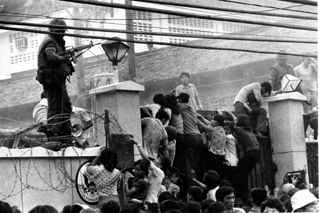 Mobs of Vietnamese people scale the wall of the U.S. Embassy in Saigon, Vietnam, trying to get to the helicopter pickup zone, just before the end of the Vietnam War on April 29, 1975. President  Bush, who has rejected Iraq-Vietnam comparisons in the past, linked the U.S. pullout in Vietnam to the rise of the Khmer Rouge in Cambodia in a speech to the Veterans of Foreign Wars convention in Kansas City Wednesday Aug. 22, 2007.(Photo by Neal Ulevich/AP Photo)