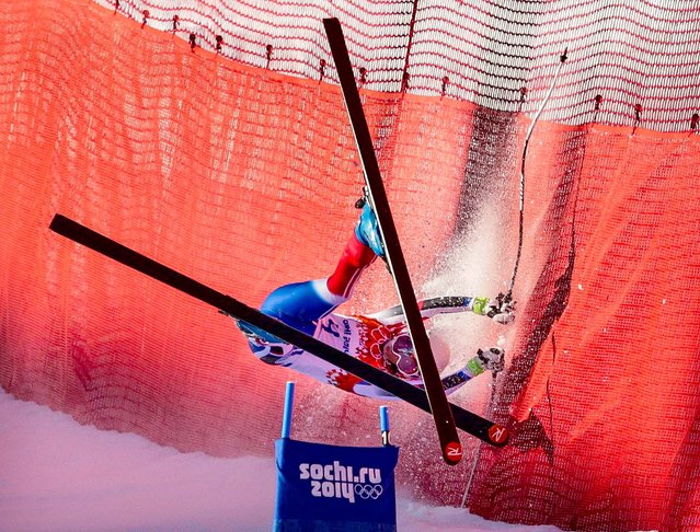 France's Marie Marchand-Arvier crashes into safety netting during the women's downhill at the Sochi 2014 Winter Olympics, on February 12, 2014. (Photo by Charles Krupa/Associated Press)