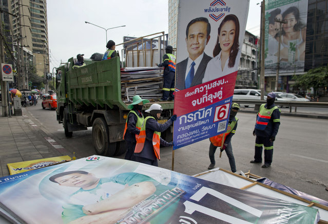 Workers load campaign billboards displayed on roadsides to promote candidates for a general election onto a truck in Bangkok, Thailand, Wednesday, March 27, 2019. The results of Sunday's general election will be formally announced on May 9. (Photo by Gemunu Amarasinghe/AP Photo)