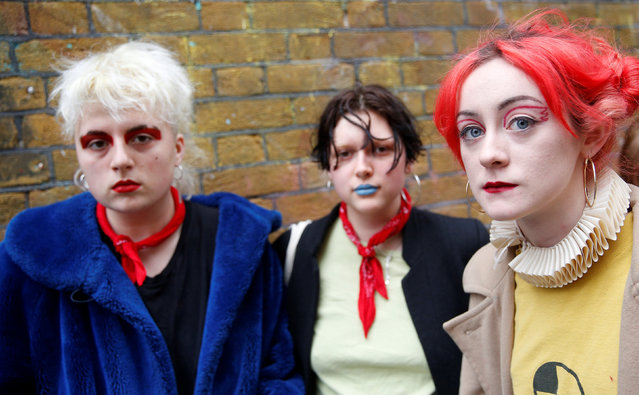 Students Alex Lovelace, Danni Nowokunska and Mia Parnell (L-R) pose for a portrait during London Fashion Week in London, Britain February 21, 2017. (Photo by Neil Hall/Reuters)