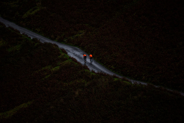 Two cyclists in the Lake District on 7 October 2017. (Photo by Rupert Hartley/Rex Features/Shutterstock)