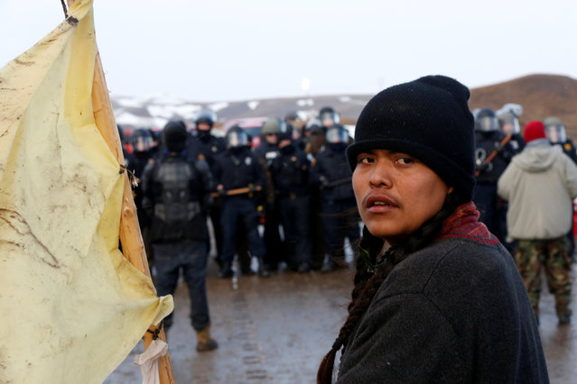 Frankie Tso Jr., 19, from the Navajo Tribe of Arizona, confronts police on the outskirts of the main opposition camp against the Dakota Access oil pipeline near Cannon Ball, North Dakota, U.S., February 22, 2017. (Photo by Terray Sylvester/Reuters)