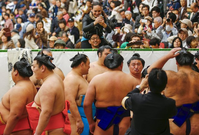 "People take pictures before start of the ""Honozumo"" ceremonial sumo tournament at the Yasukuni Shrine in Tokyo April 3, 2015. (Photo by Thomas Peter/Reuters)"