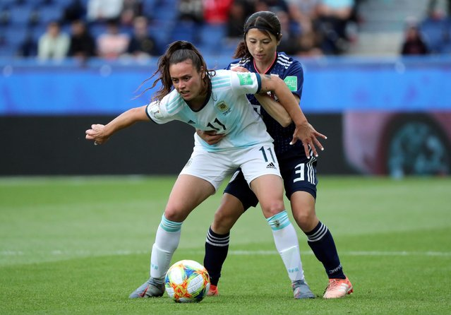 Argentina's Florencia Bonsegundo and Japan's Aya Sameshima challenge for the ball during the Women's World Cup Group D soccer match between Argentina and Japan at the Parc des Princes in Paris, France, Monday, June 10, 2019. (Photo by Lucy Nicholson/Reuters)