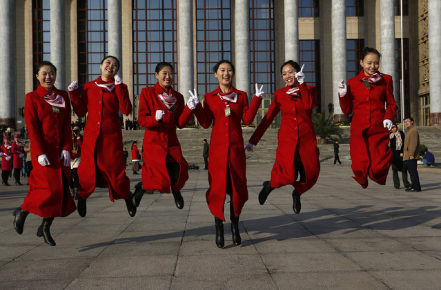 Attendants pose for a picture in front of the Great Hall of the People before the opening session of the 18th Communist Party Congress held at in Beijing, China Thursday, November 8, 2012. (Photo by Vincent Yu/AP Photo)