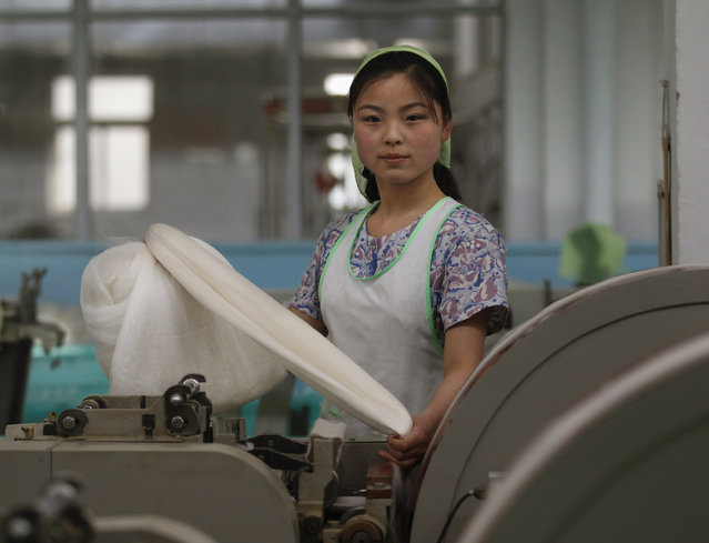 A woman works in the Kim Jong-suk Pyongyang Silk Mill in Pyongyang April 9, 2012. The factory is named after the wife of North Korea founder Kim Il-sung. (Photo by Bobby Yip/Reuters)