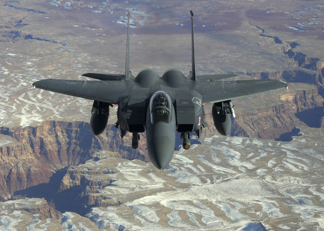 Lieutenant Colonel Jeannie Leavitt, 333rd Fighter Squadron commander, flies her F-15 fighter aircraft over the Grand Canyon en route to Nellis Air Force Base in Nevada, February 7, 2008. (Photo by Staff Sgt. Darin Moulton/Reuters/U.S. Air Force)