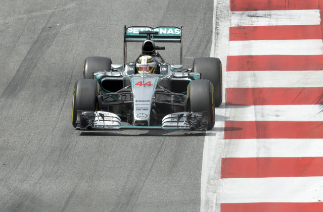 Second placed Mercedes driver Lewis Hamilton of Britain steers his car during the Austrian Formula One Grand Prix race at the Red Bull Ring  in Spielberg, southern Austria, Sunday, June 21, 2015. (AP Photo/Kerstin Joensson)