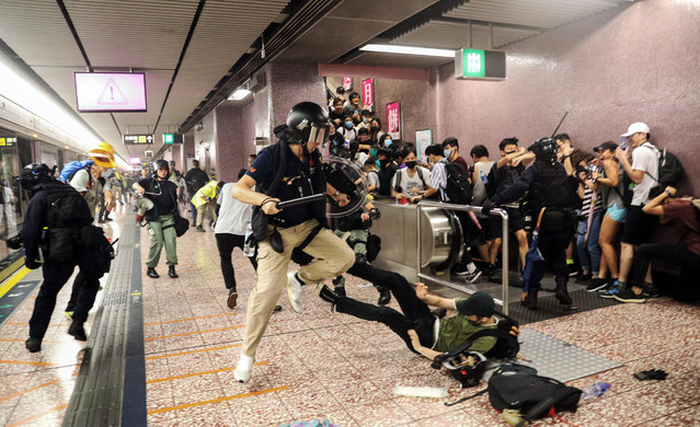Police attempt to arrest protesters at Prince Edward MTR Station, Hong Kong, Saturday, August 31, 2019. Hundreds of people are rallying in an athletic park in central Hong Kong as a 13th-straight weekend of pro-democracy protests gets underway. (Photo by Ring Yu/HK01 via AP Photo)