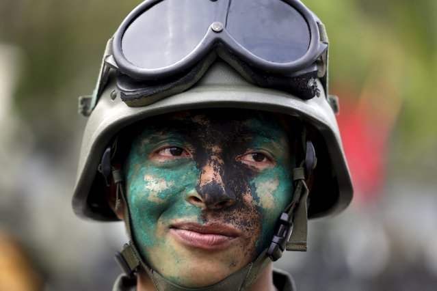 A soldier poses for a picture after a military parade to celebrate the anniversary of Venezuela's independence in Caracas, July 5, 2015. (Photo by Jorge Dan Lopez/Reuters)