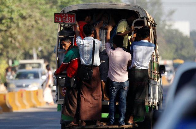 People ride a bus as they travel in Yangon, Myanmar January 14, 2017. Picture taken January 14, 2017. (Photo by Soe Zeya Tun/Reuters)