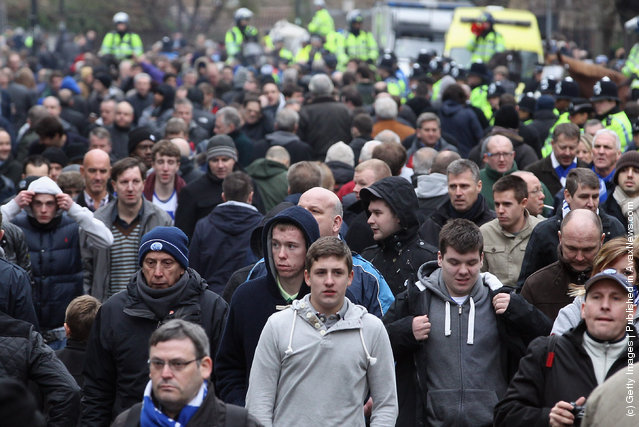 Fans leave the Loftus Road stadium after the FA Cup Fourth Round between Queens Park Rangers and Chelsea