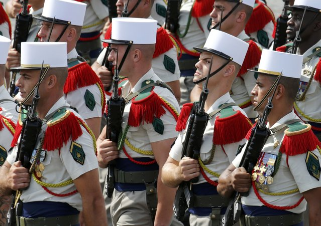 Soldiers from the French Foreign Legion march during the traditional Bastille Day military parade on the Place de la Concorde in Paris, France, July 14, 2015. (Photo by Pascal Rossignol/Reuters)