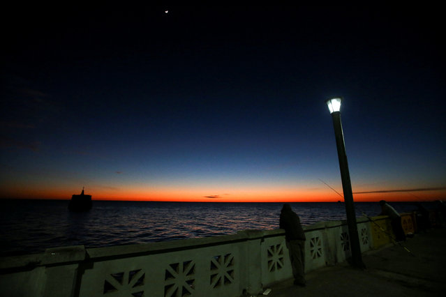 Sunrise is seen over the Rio de la Plata river in Buenos Aires, Argentina on May 29, 2019. (Photo by Agustin Marcarian/Reuters)