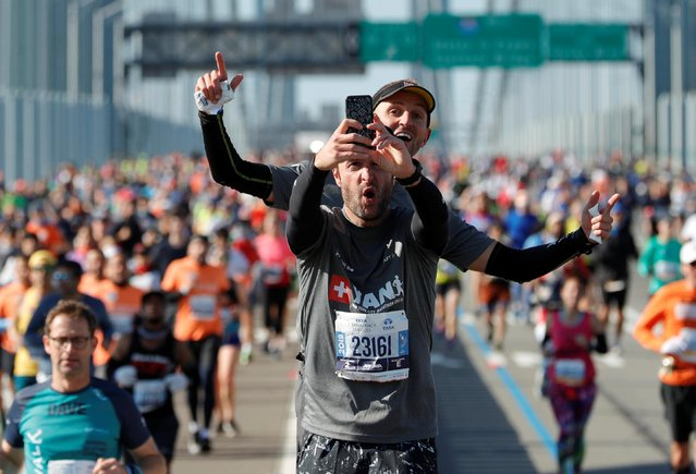 Runners taking selfies during the New York City Marathon in Manhattan, New York, United States on November 03, 2019. (Photo by /Lucas Jackson/Reuters)