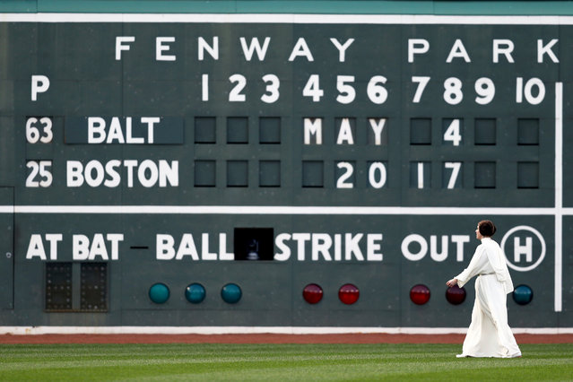 A woman dressed as Princess Leia from the Star Wars franchise walks in front of the Green Monster as part of Star Wars day at Fenway Park before the game between the Boston Red Sox and the Baltimore Orioles on May 4, 2017 in Boston, Massachusetts. (Photo by Maddie Meyer/Getty Images)