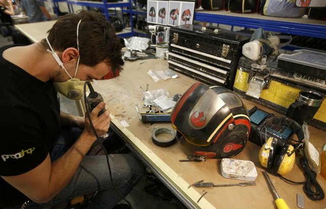 "A technician adds finishing touches to a replica of Poe Dameron's helmet from ""Star Wars: The Force Awakens"", in the Propshop headquarters at Pinewood Studios near London, Britain May 25, 2016. (Photo by Peter Nicholls/Reuters)"