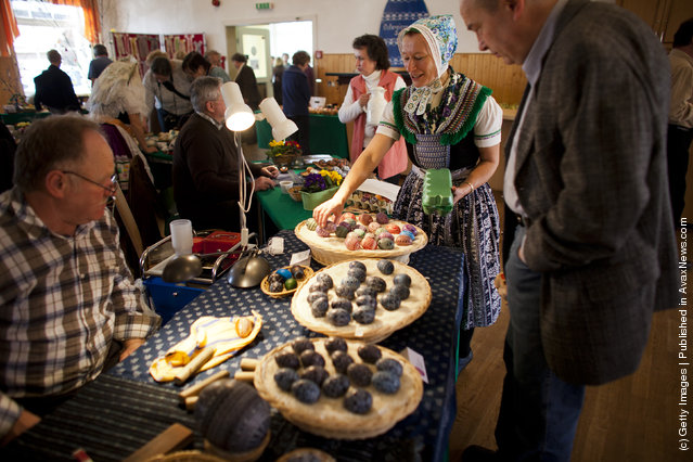 Sylvia Panoscha (C), wearing a traditional Lusatian sorbian folk dress, arranges eggs at the annual traditional Sorbian Easter egg market