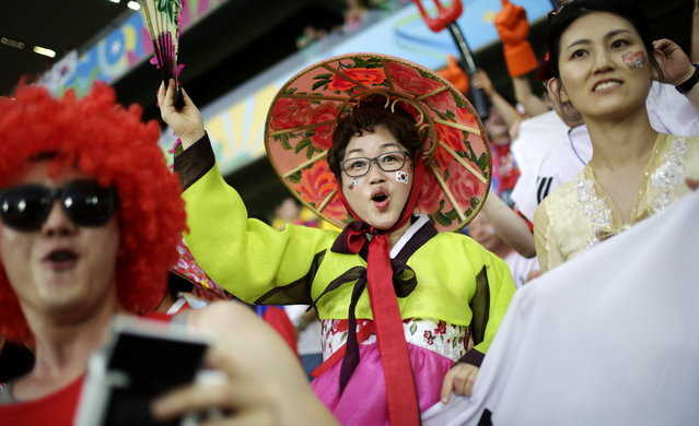 South Korean fans cheer for their national team before the group H World Cup soccer match between Russia and South Korea at the Arena Pantanal in Cuiaba, Brazil, Tuesday, June 17, 2014. (Photo by Felipe Dana/AP Photo)